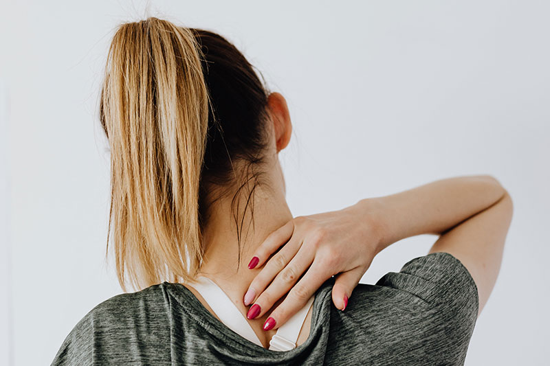 woman holding neck